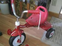 THIS TRICYCLE IS SLIGHTLY USED, SHOWS NO WEAR, NEEDS