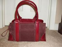 Red suede with red shiny patent leather accents. In