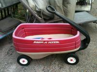 Radio flyer wagon with cup holders. CONSIGNMENT SHOP