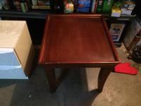 Red wood colored end table, decent size -- fair