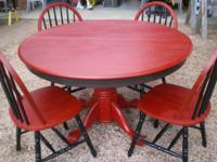 This is a very nice round table and 4 chairs that have