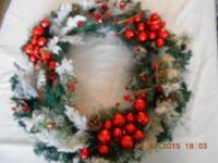 This is a gorgeous Red Berry Christmas Wreath with pine