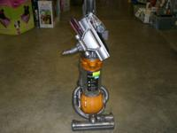 Nice Orange Dyson Ball Vacuum.  Functions:. -Bag much