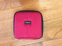 Red portable zippered CD / DVD case.  Pretty basic and