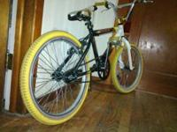 here is a redline bmx bike has a gold anodised casket