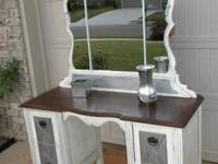 Vanity that is solid wood with beautiful details.