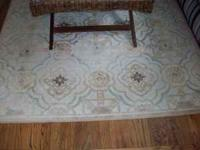 Two rugs for sale. One is 5x8 selling for $50.00. The