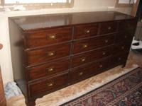 "This solid wood Heritage chest is 68"" long, 18"" deep,"