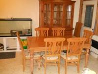 The dining room table and china cabinet are both from
