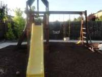 Large backyard play structure. Constructed of solid