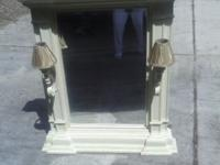 Lovely and uncommon, a large beveled mirror in a white
