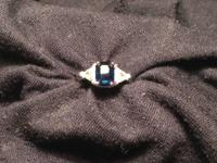 Blue Sapphire Engagement Ring with trillion diamonds.