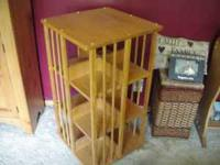 A solid oak floor (swivil) dvd/vhs holder. It holds 168
