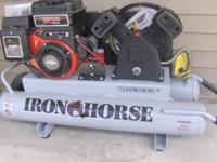 New Iron Horse, Twin Tank Wheel Barrow Type. 11cfm @