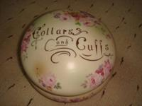 This beautiful COLLARS and CUFFS container is in