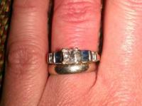 Sz 6 A little over half karet diamond with 4 bagget