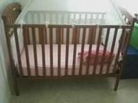 The Storkcraft Charlotte 4-in-1 crib features solid