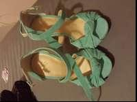 Brand name new, stilleto's. Absolutely gorgeous color,