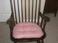 This is a dark wooden rocking chair in great shape.