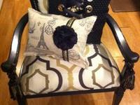 Amazing accent chair covered in a soft gold and black