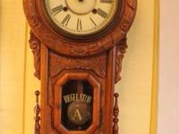 "Light Brown Wood. ""Regulator A"" Carved Wall Clock is"