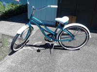 Blue, excellent Condition, rode at the most 10 miles,