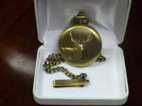 Gold tone Remington Pocket Watch. Cover has embossed