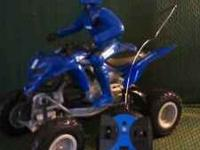 Remote controlled Yamaha 4 wheeler/atv with rider.