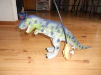 Remote control dinosaur. Like New, hardly played with.