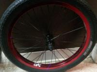 (Mint condition. ) only ridden once. Powder coated red