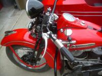 A very nicely restored 1948 Harley with matching