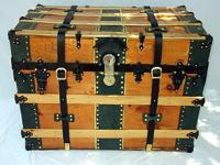 Antique arch-top carriage trunk in a natural pine