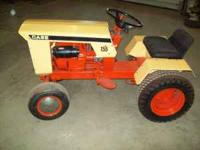 This is a restored 1968 case 155 Garden Tractor.