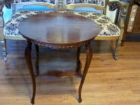 This gorgeous walnut table is a Louis XV design. The
