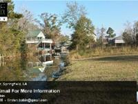 Beautiful 70x52 Restricted Waterfront lot just a short