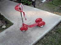WE BOUGHT THIS ALL METAL SCOOTER, AND NEVER USED IT FOR