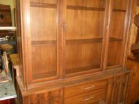 Retro era solid wood china cabinet. Glass doors with