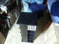FOR  SALE  REVOLVING  WOODEN  CD  RACK  AS  PICTURED.