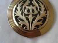 This is a Richard Hudnut compact. Its design is one I