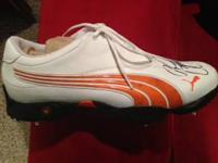 Orange and white puma golf shoe. Comes with COA.