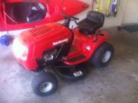1 and 1/2 year old riding lawn mower in excellent