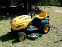 RIDING LAWN MOWER WITH GRASS CATCHERS. $600.00 OBO OR