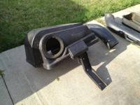 This is a bagger system for a riding mower. It has been