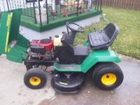 "Two riding lawn mowers. One weedeater with a 36"" deck,"