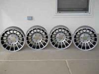 "Four 15"" racing aluminum rims that will fit on a Mopar"
