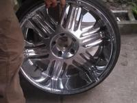 FOUR RIMS AND TIRES WITH ADAPTER FOR SELL $1500. 00 IN