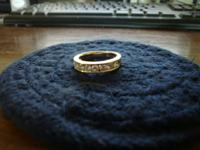 have a 14 kt yellow gold ring with 10-10 point