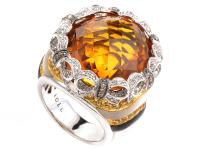 This ring is festive and fun. It is made primarily of