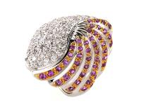 This ring is custom designed to feature exquisite color