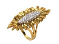 This ring is elaborate and refined. It is made of 18K
